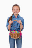 Portrait of a girl holding a basket full of Easter eggs Stock Image