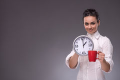Portrait of girl holding a big clock Stock Photos