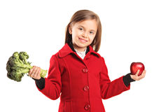 Portrait of a girl holding broccoli and apple Stock Image