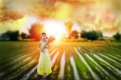 portrait of girl holding flowers at field Royalty Free Stock Photography