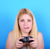 Portrait of girl holding game controller and playing games again Stock Photos
