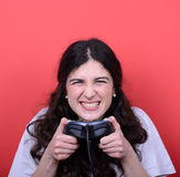 Portrait of girl holding game controller and playing games again Stock Photo