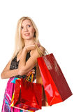 Portrait of a girl holding handbags and smiling Royalty Free Stock Image