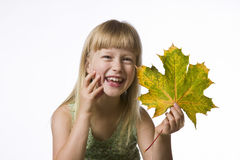 Portrait of a girl holding a maple leaf Royalty Free Stock Photos