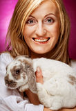 Portrait girl holding rabbit on hand Royalty Free Stock Photo