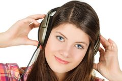 The portrait of girl that holds hands headsets Royalty Free Stock Photos