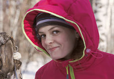 Portrait of girl in hooded jacket in the winter forest Royalty Free Stock Photo