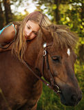 Portrait of a girl on horseback Royalty Free Stock Images