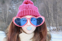 Portrait  girl in huge glasses and gum-chewing Royalty Free Stock Photo