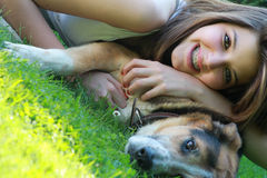 Portrait of girl hugged to her dog Royalty Free Stock Photos