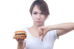 Portrait of girl with humburger showing thumb down Royalty Free Stock Photo