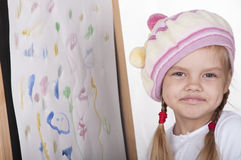 Portrait of a girl in the image of the artist, near the drawn her picture Royalty Free Stock Photos