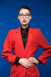Portrait of a girl in a jacket with red lipstick Royalty Free Stock Photos
