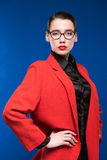 Portrait of a girl in a jacket with red lipstick Stock Image