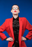 Portrait of a girl in a jacket with red lipstick Royalty Free Stock Image