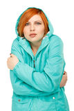 Portrait of a girl in a jacket with a trembling from the cold. Isolated on white background Royalty Free Stock Images