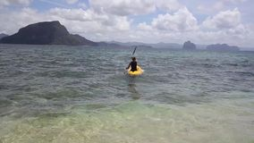 Portrait of a girl in kayak. In the Philippines stock video footage