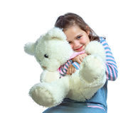 Portrait of a girl keep a bear on a white background Royalty Free Stock Photography