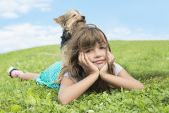 Portrait of girl keeping pretty dog outdoor Stock Image