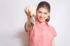 Portrait of the girl with keys in hands. Royalty Free Stock Photography