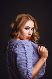 Portrait of a girl in a knitted cardigan Royalty Free Stock Photos