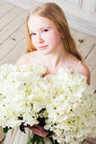 Portrait of a girl with a large bouquet of flowers Royalty Free Stock Photos