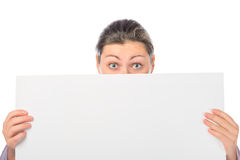 Portrait of a girl   with a large white poster Stock Image