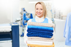 Portrait of a girl Laundry worker holding a clean towel Royalty Free Stock Photos