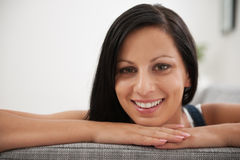 Portrait of girl laying on sofa in living room Stock Photos