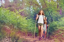 Girl leading a group of kids on hiking trail Royalty Free Stock Photos