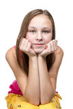 Portrait of a girl leaned on his hands Stock Photos