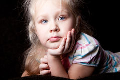 Portrait of a girl leaning on the arm of the Child. Cute portrait of a girl leaning on the arm of the Child Royalty Free Stock Photos