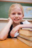 Portrait of a girl leaning on books Stock Image