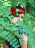 Portrait of the girl in leaves Stock Photography