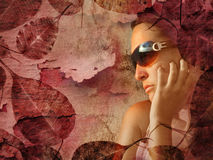Portrait of girl and leaves. Sepia portrait of pensive girl in a frame of dead leaves and an old texture background, she is wearing sunglasses that reflect the stock photos