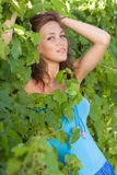 Portrait of a girl in the leaves of grape Stock Images