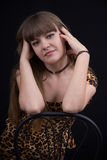 Portrait of girl in leopard print dress Royalty Free Stock Photography