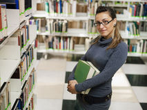 Portrait of girl in library Stock Photography