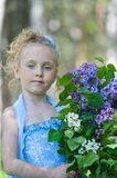 Portrait of girl with lilacs Royalty Free Stock Photos