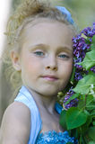 Portrait of girl with lilacs Stock Photos