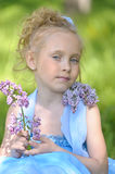 Portrait of girl with lilacs Royalty Free Stock Photo