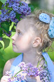 Portrait of girl with lilacs Royalty Free Stock Images