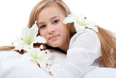 Portrait of a girl with lilies. Royalty Free Stock Images
