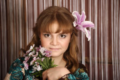 Portrait of a girl with a lily Stock Image