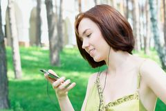 Portrait of a girl listening to music Royalty Free Stock Image