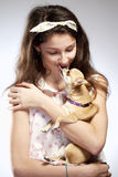 Portrait of a Girl with a Little Dog Stock Images