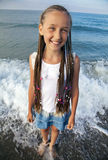 Portrait of a girl with long braids on her head. To the sea Royalty Free Stock Photos