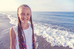 Portrait of a girl with long braids on her head. To the sea Royalty Free Stock Image