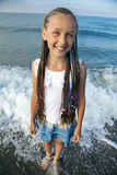 Portrait of a girl with long braids on her head. To the sea Royalty Free Stock Photo