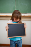 Portrait of a girl looking at a school slate Royalty Free Stock Image